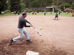 League founder Gary Robinson takes batting practice before a game to mark the 50th season of the Montclair softball league, Saturday, April 22, 2017, at Montclair Park in Oakland, Calif. The pickup softball game, played every Saturday by a group of enthusiasts ranging in age from 20 to 75, started in 1968 in Berkeley and moved to Montclair about 25 years ago. (Photo by D. Ross Cameron)