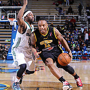 Delaware 87ers Guard Maalik Wayns (12) drives the lane as Reno Bighorns Guard Tajuan Porter (12) defends in the first half of a NBA D-league regular season basketball game between the Delaware 87ers and the Reno Bighorns (Sacramento Kings), Tuesday, Feb. 10, 2015 at The Bob Carpenter Sports Convocation Center in Newark, DEL