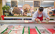 Owner Artie Elias, surveys the oysters at his butcher Shop in Roanoke Rapids, North Carolina.