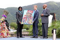 Prince Harry receives a painting after unveiled the St. Kitts and Nevis dedication to The Queen's Commonwealth Canopy Project at Brimstone Hill Fort after arriving on the island of St Kitts for the second leg of his Caribbean tour.