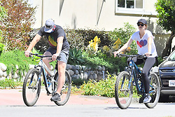 a pregnant Katherine Schwarzenegger Pratt and her husband Chris Pratt head out on a bike ride in Santa Monica. The pair were happy and Katherine's Baby bump was clearly visible under her white shirt. 25 Apr 2020 Pictured: Katherine Schwarzenegger Pratt and Chris Pratt. Photo credit: Snorlax / MEGA TheMegaAgency.com +1 888 505 6342