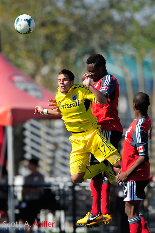 Columbus Crew forward Ben Speas (17) and Toronto FC defender Gale Agbossoumonde (6) go airborne for a ball during the Disney Pro Soccer Classic on Feb 9, 2013  in Lake Beuna Vista, Florida. ..©2013 Scott A. Miller