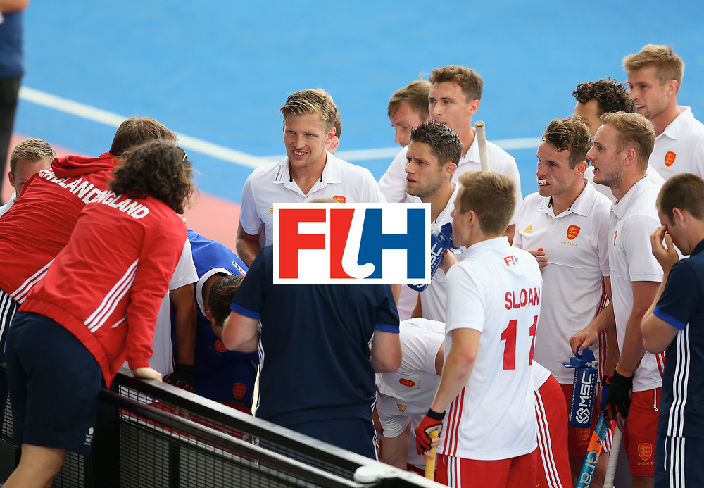 LONDON, ENGLAND - JUNE 25: England players recieve instructions during the 3rd/4th place match between Malaysia and England on day nine of the Hero Hockey World League Semi-Final at Lee Valley Hockey and Tennis Centre on June 25, 2017 in London, England. (Photo by Steve Bardens/Getty Images)