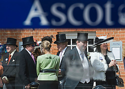 © licensed to London News Pictures. 14/06/2011. Ascot, UK.  Day one at Royal Ascot races today (14/03/2011). The 5 day showcase event,  one of the highlights of the racing calendar is in it's 300th year. Horse racing has been held at the famous Berkshire course since 1711 and tradition is a hallmark of the meeting. Top hats and tails remain compulsory in parts of the course. Photo credit should read: Ben Cawthra/LNP