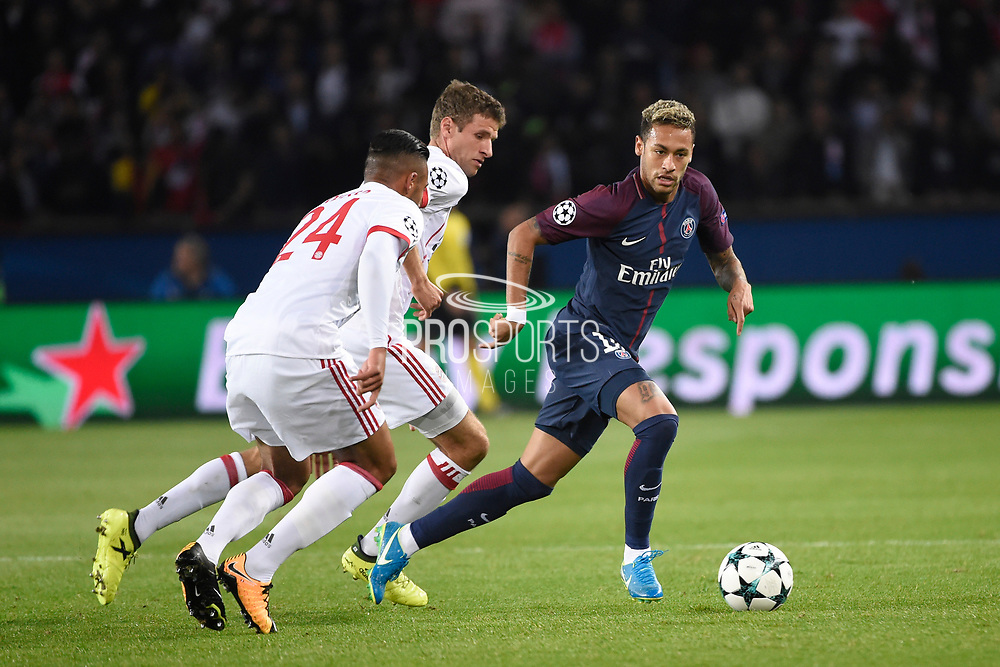 Brazilian forward Neymar Jr of Paris Saint Germain competes with German forward Thomas Muller and French midfielder Corentin Tolisso of Bayern Munich during the UEFA Champions League, Group B football match between Paris Saint-Germain and Bayern Munich on September 27, 2017 at Parc des Princes stadium in Paris, France - Photo Jean Marie Hervio / Regamedia / ProSportsImages / DPPI