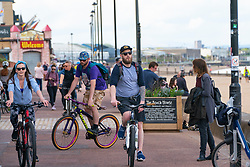 Portobello, Scotland, UK. 9 May 2020. Images from holiday weekend Saturday afternoon during Covid-19 lockdown on promenade at Portobello. Promenade and beach were relatively quiet with a low key police presence. Pictured;  Narrow sections of promenade gets busy with cyclists and pedestrians. Iain Masterton/Alamy Live News