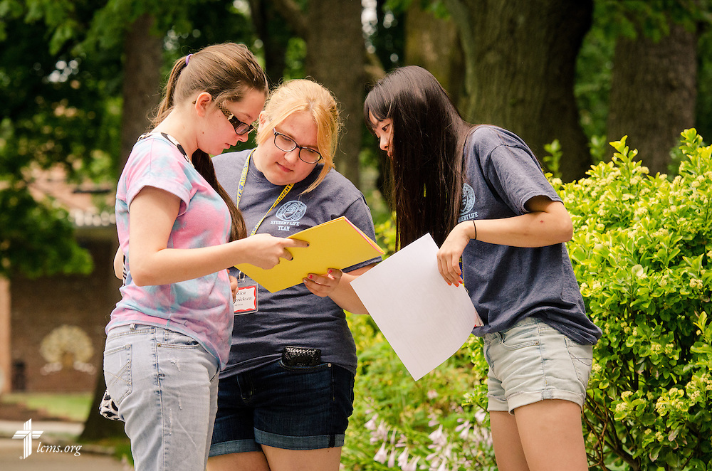 Jessica Fredericksen (center) and Irene Yang help a new student at Concordia College New York on Saturday, July 19, 2014, in Bronxville, NY. LCMS Communications/Erik M. Lunsford