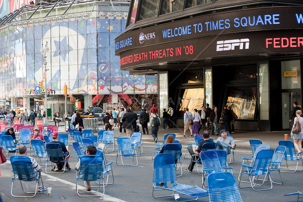 Blue Folding Chairs On The Street In Times Square, NY