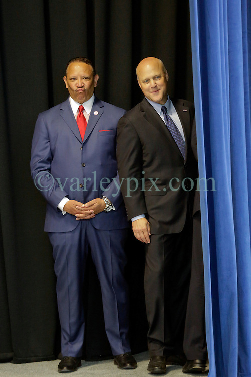 27 August 2015. Andrew P. Sanchez & Copelin-Byrd Multi Service Center, Lower 9th Ward, New orleans, Louisiana.<br /> Marc Morial, president of the National Urban League and former Mayor of New Orleans with current Mayor Mitch Landrieu looking from backstage before President Barack Obama speaks. <br /> Photo credit©; Charlie Varley/varleypix.com.