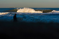 Feb 27, 2013; Virginia Beach; VA; A wave crashes during a swell near 25th Street. Mandatory Credit: Peter J. Casey