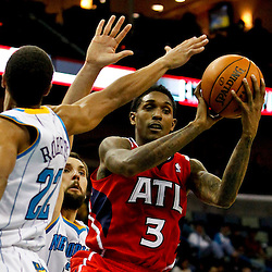 Jan 1, 2013; New Orleans, LA, USA; Atlanta Hawks shooting guard Louis Williams (3) is defended by New Orleans Hornets point guard Brian Roberts (22) and power forward Ryan Anderson (33) during the second half of a game at the New Orleans Arena. The Hawks defeated the Hornets 95-86. Mandatory Credit: Derick E. Hingle-USA TODAY Sports