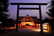 People pray at the main hall of Yasukuni Shrine in Tokyo, Japan. Every year on August 15, the day Japan officially surrendered in WWII, tens of thousands of Japanese visit the controversial shrine to pay their respects to the 2.46 million war dead enshrined there, the majority of which are soldiers and others killed in WWII and including 14 Class A convicted war criminals, such as Japan's war-time prime minister Hideki Tojo. Each year speculation escalates as to whether the country's political leaders will visit the shrine, the last to do so being Junichiro Koizumi in 2005. Nationalism in Japan is reportedly on the rise, while sentiment against the nation by countries that suffered from Japan's wartime brutality, such as China, has been further aggravated by Japan's insistence on glossing over its wartime atrocities in school text books...Photographer:Robert Gilhooly....Photographer:Robert Gilhooly