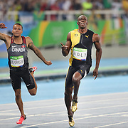 Athletics - Olympics: Day 9  Usain Bolt of Jamaica winning the Men's 100m Final with Andre De Grasse, (left), of Canada fishing in third place at the Olympic Stadium on August 14, 2016 in Rio de Janeiro, Brazil. (Photo by Tim Clayton/Corbis via Getty Images)
