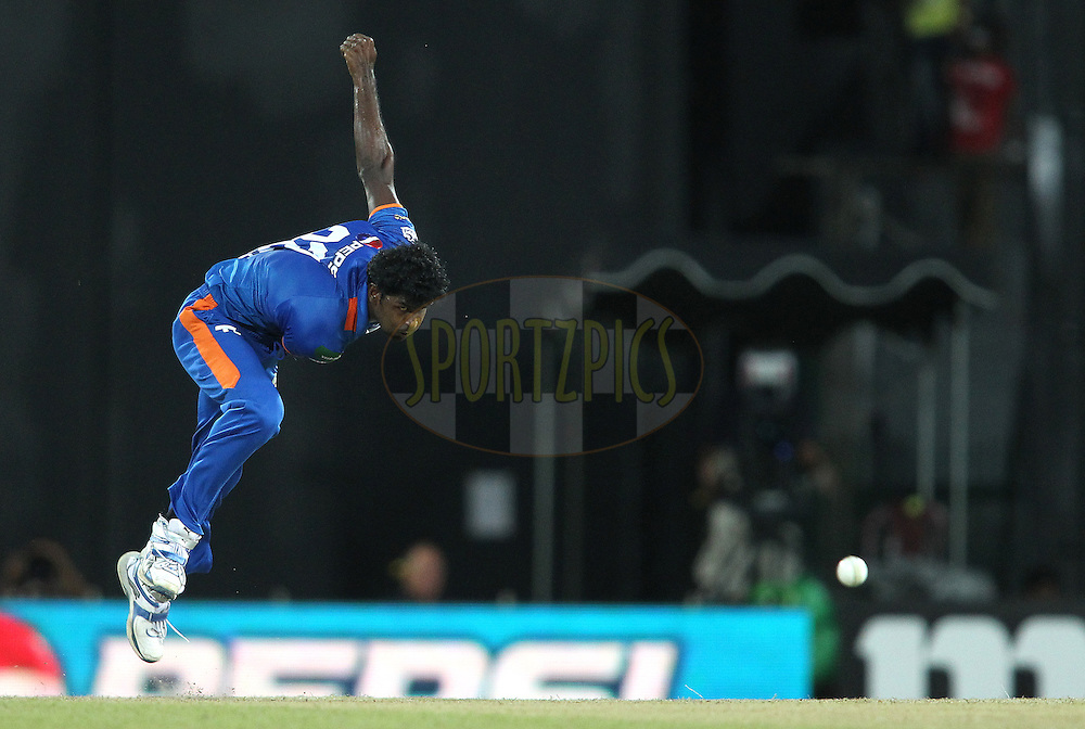 Shamindra Eranga of Nagenahira Nagas sends down a delivery during match 21 of the Sri Lankan Premier League between Uva Next and Nagenahiras held at the Premadasa Stadium in Colombo, Sri Lanka on the 27th August 2012. .Photo by Shaun Roy/SPORTZPICS/SLPL