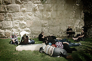 Christians pilgrims take a rest during the Good Friday day in Jerusalem's old city on April 2, 2010