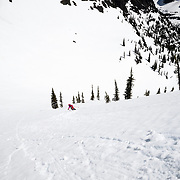 Lynsey Dyer skiing a backcountry line in Glacier National Park.