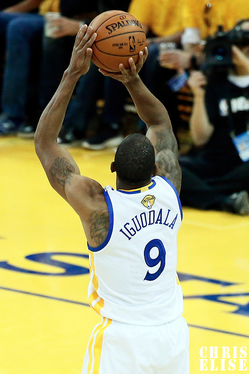 12 June 2017: Golden State Warriors forward Andre Iguodala (9) takes a jump shot during the Golden State Warriors 129-120 victory over the Cleveland Cavaliers, in game 5 of the 2017 NBA Finals, at the Oracle Arena, Oakland, California, USA.