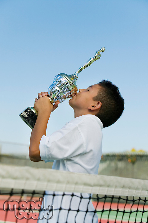 Tennis Player Kissing Trophy