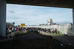October 27, 2016 - Calais, France - Minors have been told that a bs will pick them up after tthe bridge, next to the entrance of the jungle, to bring them to a center. Calais 27/10/2016  (Credit Image: © Guillaume Pinon/NurPhoto via ZUMA Press)