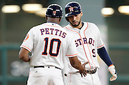 Jun 22, 2016; Houston, TX, USA; Houston Astros third base coach Gary Pettis (10) congratulates first baseman Marwin Gonzalez (9) on his RBI triple against the Los Angeles Angels in the eighth inning at Minute Maid Park. Mandatory Credit: Thomas B. Shea-USA TODAY Sports