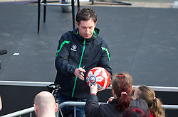 LIVERPOOL, ENGLAND - Thursday, April 10, 2014: Robbie Fowler signs a ball ahead of the launch of the new Liverpool FC Warrior home kit for 2014/2015 at the Liverpool One shopping centre. (Pic by David Rawcliffe/Propaganda)