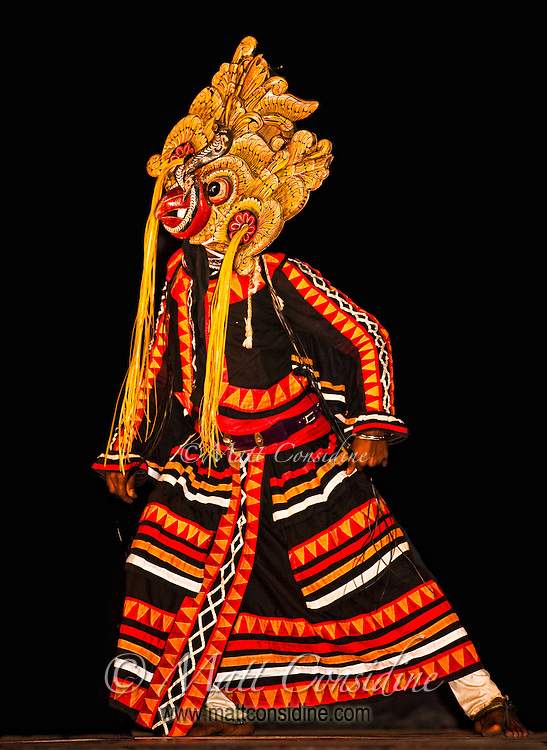 A spectacular bird mask, with a cobra in the beak.<br /> (Photo by Matt Considine - Images of Asia Collection)