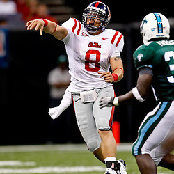 Sep 11, 2010; New Orleans, LA, USA; Mississippi Rebels quarterback Jeremiah Masoli (8) throws as Tulane Green Wave linebacker Darryl Farley (34) pressures during the first half at the Louisiana Superdome.  Mandatory Credit: Derick E. Hingle