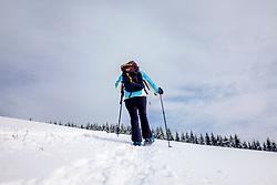 THEMENBILD - Eine Frau mit Rucksack bei einer Schneeschuhwanderung auf einer verschneiten Bergkuppe am 26. Februar 2018 am Heulantsch bei Fladnitz an der Teichalm // THEMES PICTURE - a woman during a snowhike with snowshoes on a snowy mountain near the Teichalm on 26 February 2018, Fladnitz, Austra. EXPA Pictures © 2018, PhotoCredit: EXPA/ Erwin Scheriau