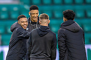 Jake Mulraney (#23)(left) shares a joke with Sean Clare (#9), Callumn Morrison (#38), Demetri Mitchell (#11)  of Heart of Midlothian during the Ladbrokes Scottish Premiership match between Hibernian FC and Heart of Midlothian FC at Easter Road Stadium, Edinburgh, Scotland on 29 December 2018.
