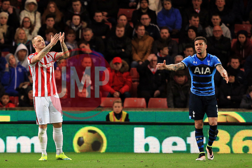 Marko Arnautovic of Stoke City and Kyle Walker of Tottenham Hotspur react in frustration - Mandatory by-line: Matt McNulty/JMP - 18/04/2016 - FOOTBALL - Britannia Stadium - Stoke, England - Stoke City v Tottenham Hotspur - Barclays Premier League