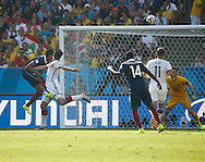 Mats Hummels of Germany (L white) scores their first goal during the 2014 FIFA World Cup match between France and Germany at the Maracana Stadium, Rio de Janeiro<br /> Picture by Andrew Tobin/Focus Images Ltd +44 7710 761829<br /> 04/07/2014
