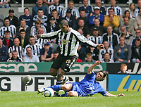 Photo. Andrew Unwin.<br /> Newcastle United v Chelsea, Barclays Premiership, St James' Park, Newcastle upon Tyne 15/05/2005.<br /> Chelsea's Tiago (R) slides in on Newcastle's Titus Bramble (L).