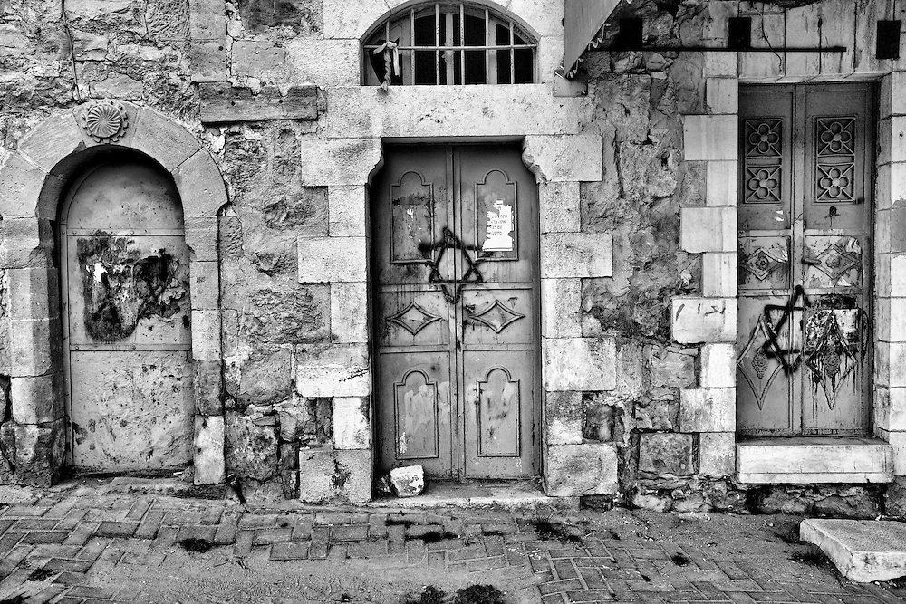 A long vacant Palestinian home in the old city of Hebron has been vandalized in a practice known as price tagging. Mar. 22, 2011. West Bank, Palestine.