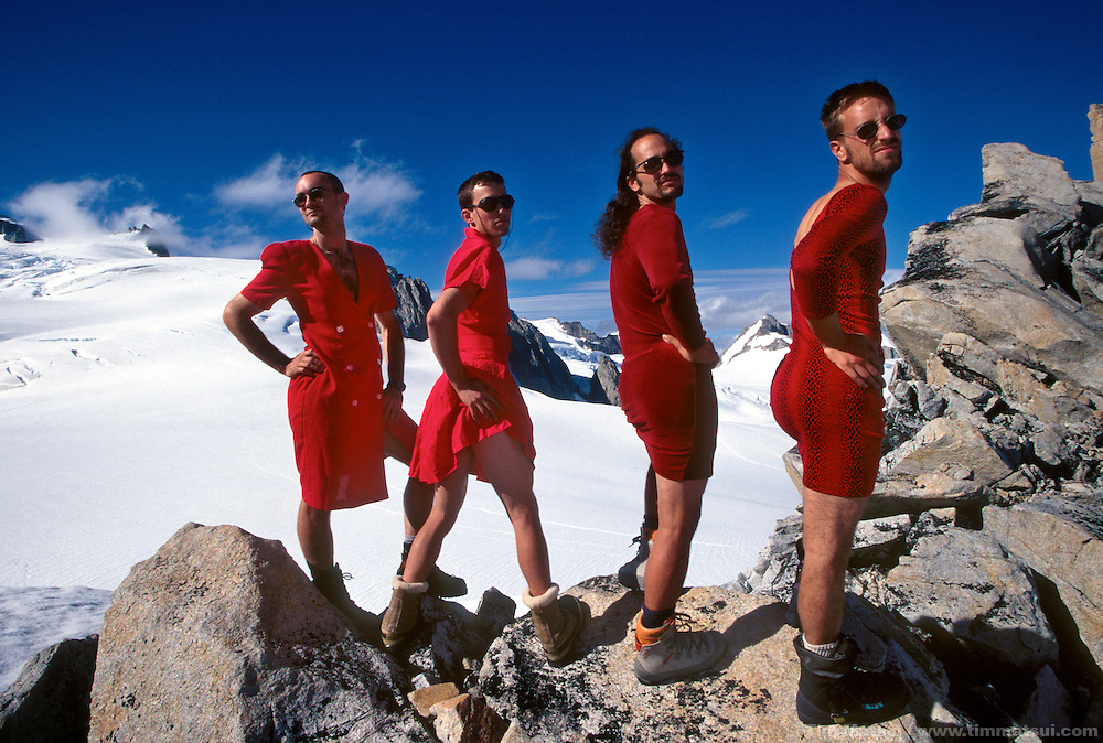 Men in red dresses in the mountains. Coast Range, British Columbia.