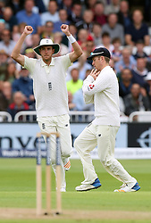 England's Stuart Broad celebrates as Liam Dawson (right) catches South Africa's Vernon Philander during day two of the Second Investec Test match at Trent Bridge, Nottingham.