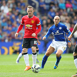 Manchester United's Wayne Rooney on the ball during the Barclays Premiership match between Leicester City FC and Manchester United FC, at the King Power Stadium, Leicester, 21st September 2014 © Phil Duncan | SportPix.org.uk