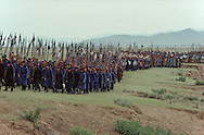 Mongolia. Mr. Baljiniam shooting Gengis Khan movie; Battle scenes, and the army on the march.    Underchirit