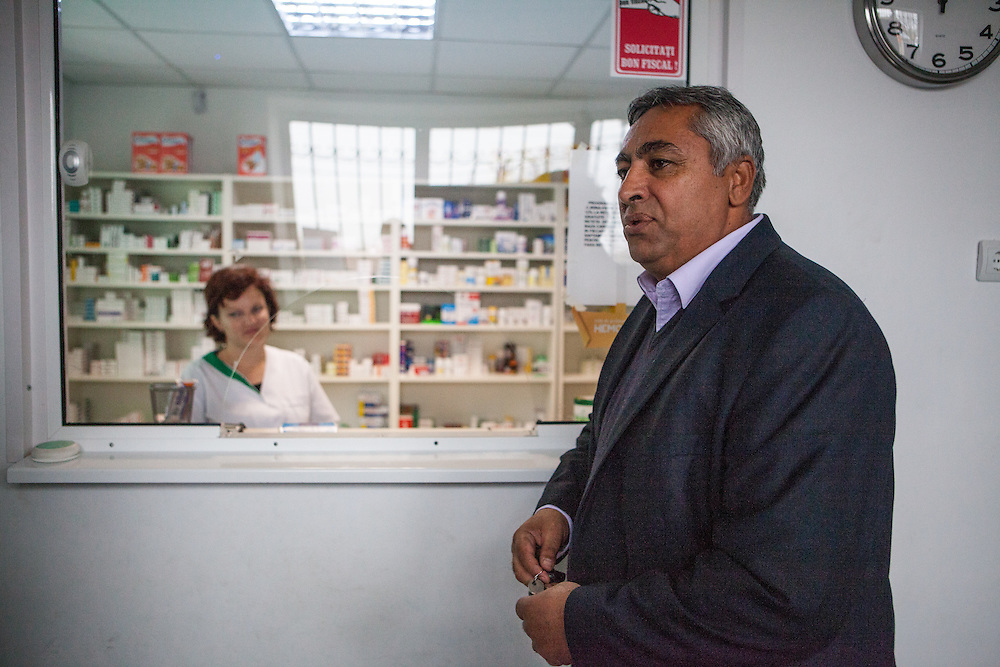 Portrait of Roma activist Gheorghe Tudor in the local pharmacy - which he helped to get built - in the village of Marginenii de Jos.