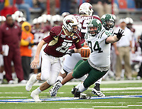 Louisiana-Monroe quarterback Kolton Browning (15) evades Ohio defensive lineman Cory Hasting (94) during the first quarter of the Independence Bowl NCAA college football game in Shreveport, La., Friday, Dec. 28, 2012.