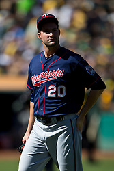 OAKLAND, CA - SEPTEMBER 22: Josh Roenicke #20 of the Minnesota Twins reacts after giving up a run against the Oakland Athletics during the fifth inning at O.co Coliseum on September 22, 2013 in Oakland, California. The Oakland Athletics defeated the Minnesota Twins 11-7 as they clinched the American League West Division. (Photo by Jason O. Watson/Getty Images) *** Local Caption *** Josh Roenicke