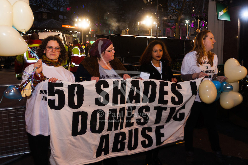 "Leicester Square, London, February 12th 2015. Women camoaigning against domestic violence demonstrate at the premiere of the much anticipated Fifty Shades of Grey in London's Leicester Square.The strong BDSM theme in the film is claimed by the protesters to ""celebrate domestic abuse"" and the ""normalisation of abusive relationships""."