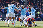 Manchester City midfielder David Silva (21) steps over Crystal Palace midfielder James McArthur (18) during the Premier League match between Crystal Palace and Manchester City at Selhurst Park, London, England on 14 April 2019.