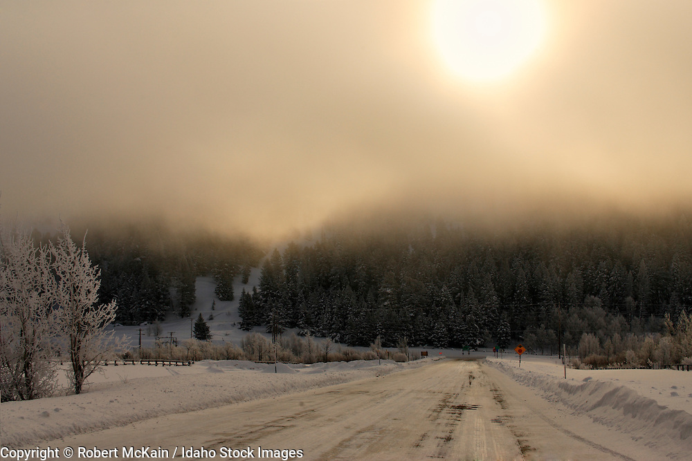 IDAHO. Henry's Lake Junction, State Highway 20. Afternoon sun through clouds in winter. #lu06006