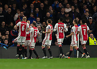 Football - 2019 / 2020 UEFA Champions League - Group H: Chelsea vs. Ajax<br /> <br /> Ajax players celebrate after Tammy Abraham (Chelsea FC) deflects a free kick to give them the lead at Stamford Bridge <br /> <br /> COLORSPORT/DANIEL BEARHAM