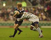 Twickenham, England, RFU Twickenham Stadium, Surrey, 10.12.2002.<br /> 2002 Varsity Rugby - Oxford vs Cambridge<br /> Oxford's Will Rubie is caught by Cambridge's Akinola Abiola    [Mandatory Credit:Peter SPURRIER/Intersport Images]