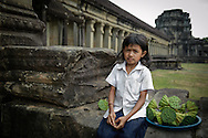 Cambodia. A young Khmer girl, lotus seller in Angkor Wat.