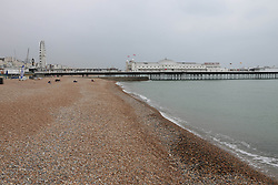 © Licensed to London News Pictures. 10/09/2014. Brighton, UK. Thursday September 11th 2014 lunchtime on an nearly empty Brighton Beach. The weather is expected to be cloudy with temperatures expected to reach around 14C in Brighton and the South Coast. Photo credit : Hugo Michiels/LNP