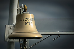 The brass ship's bell of the M/V LeConte is positioned at the bow of the ferry. The LeConte is a ferry in the Alaska Marine Highway system. It often travels the northern Lynn Canal route between Juneau, Haines and Skagway.