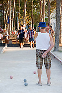 Men play petanque near Nin, Croatia (13 August 2012)