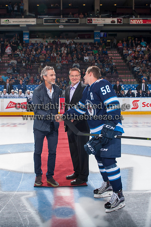 PENTICTON, CANADA - SEPTEMBER 8: Vancouver Canucks GM Trevor Linden shakes hands with Jansen Harkins #58 of Winnipeg Jets on September 8, 2017 at the South Okanagan Event Centre in Penticton, British Columbia, Canada.  (Photo by Marissa Baecker/Shoot the Breeze)  *** Local Caption ***